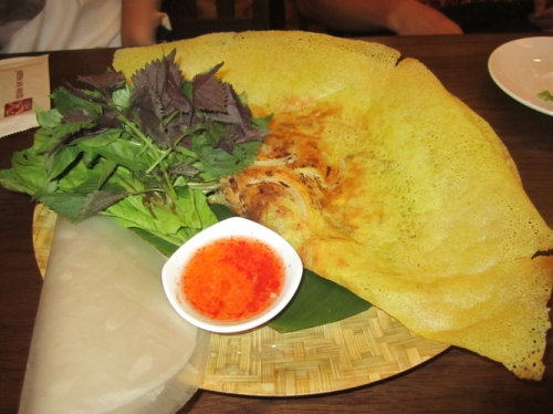 My favorite dish, the pancake. You take the rice paper, add the veg, then take a piece of the pancake, add some sauce, and roll it like a burrito!
