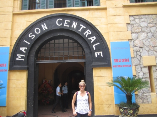 "Me in front of the prison. Even though I am smiling, it was not what I would consider a ""happy"" spot"