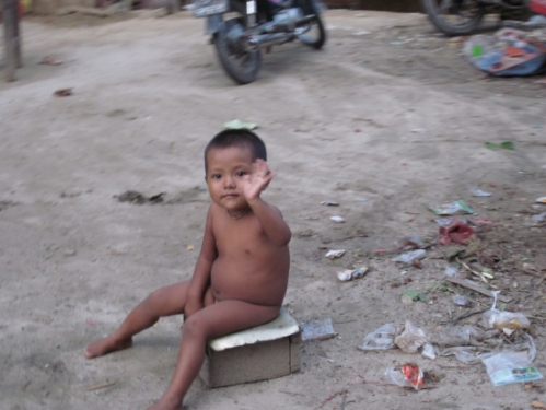 This kid, sitting naked on garbage tugged at my heart strings