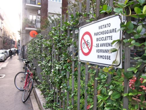 This sign explains that you are not allowed to lock your bike to the fence. Looks like someone wasn't paying attention