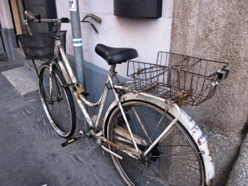 A rusted bike basket