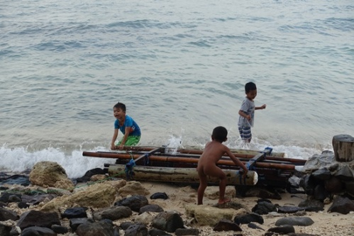 Some kiddies building a raft on a more local beach area.