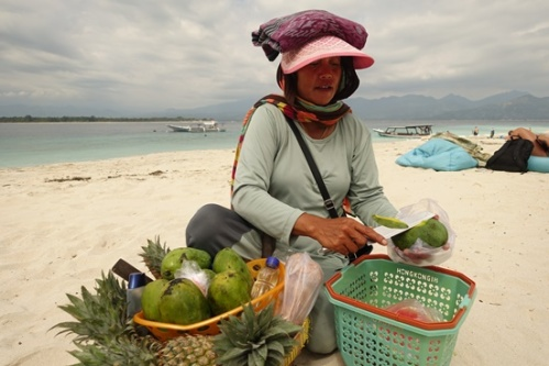 Buying a fresh mango on the beach.