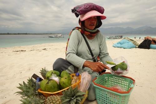 Buying a fresh mango on the beach.