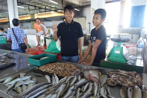 Boys selling fish.